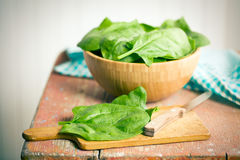 Green spinach leaves on old table Stock Photos
