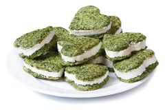 Green spinach pastries with cream cheese in the shape of heart Royalty Free Stock Photography