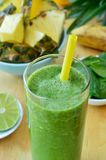 Green spinach and pineapple smoothie Stock Photos