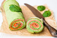 Green  spinach roll with smoked salted salmon and cream cheese Stock Images