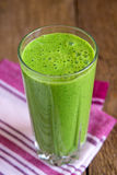 Green spinach smoothie Stock Photos