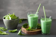 Green spinach smoothie with spirulina, chia seed, lime, apple royalty free stock photo