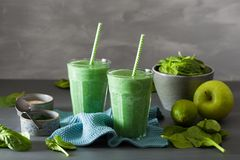 Green spinach smoothie with spirulina, chia seed, lime, apple stock photo