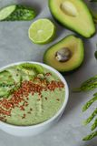 Green Spinach Smoothy Bowl Topped With Cucumber, Avocado And Flax Seeds On Stone Background Stock Images