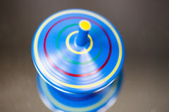 Green spinning top, macro, play, children, child play, toy Royalty Free Stock Photography