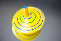 Green spinning top, macro, play, children, child play, toy Royalty Free Stock Photos