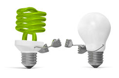 Green spiral light bulb and white tungsten one fighting Stock Photos