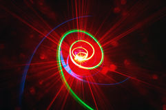 Green spiral with red rays. A green spiral ascending to red light rays with dots Royalty Free Stock Photography