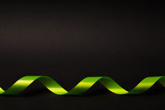 Green spiral tape on dark background Royalty Free Stock Images