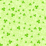 Green spirals and clover backgrounds Stock Images