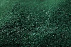Green spirulina algae powder as background. Closeup royalty free stock image