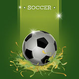Green splatter soccer ball. Abstract soccer ball with green splatter background Royalty Free Stock Images