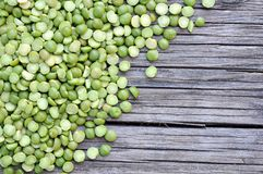 Green split pea. A pile of green split pea on grunge background Royalty Free Stock Images