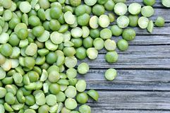 Green split pea. A pile of green split pea on grunge background Stock Image