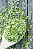 Green split pea. A pile of green split pea on grunge background Royalty Free Stock Photo