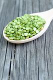 Green split pea. A pile of green split pea on grunge background Stock Photography