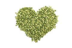 Green split peas in a heart shape Royalty Free Stock Image