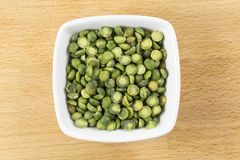 Green Split Peas. Split peas are a legume grown for drying. Green split peas are sweeter and less starchy yhen the yellow and they are high in protein and fiber royalty free stock photography