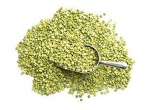 Green split peas in metal scoop. Royalty Free Stock Photos