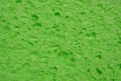 Green sponge. Bright green sponge Royalty Free Stock Photos