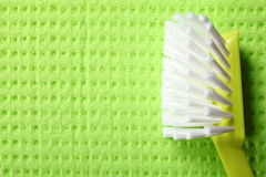 Green sponge background and brush Royalty Free Stock Photos