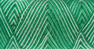 Green spool of thread Stock Images