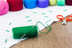 Green spool of thread with needle Stock Image