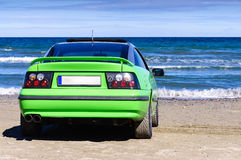 Green sport car on beach Stock Images