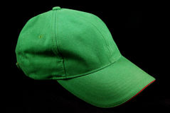 Green sports cap. Isolated on a black background Stock Photography