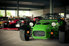 Green sports car caterham. The green sports car caterham costs in garage. Collection of cars of the son of madam Nong Nooch Stock Images