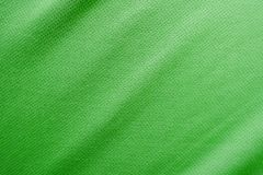 Sports clothing fabric jersey texture. Green sports clothing fabric jersey texture Royalty Free Stock Images