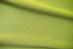Green sports clothing fabric jersey texture. Close up Stock Photo