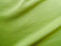Sports clothing fabric jersey texture. Green sports clothing fabric jersey texture Stock Photo