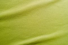 Sports clothing fabric jersey texture. Green sports clothing fabric jersey texture Stock Image