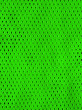 Green sports jersey. Mesh background Royalty Free Stock Images