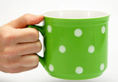 Green spotted mug Royalty Free Stock Photos
