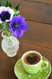 Green spotty mug and anemones Stock Photos