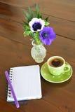 Green spotty mug and note pad Royalty Free Stock Photo