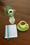 Green spotty mug and note pad Stock Photo