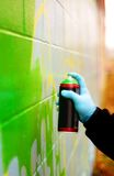 Green Spray. An urban male spraypainting a wall with green paint Royalty Free Stock Photo
