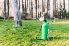 Green sprayer on spring garden Royalty Free Stock Photos