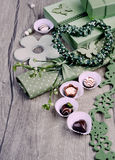 Green spring arrangement with chocolate pralines Royalty Free Stock Image