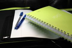 Green Spring Bind Book Beside 2 Blue Pens Royalty Free Stock Images