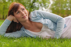 Green springtime female. Female relaxing on the green ground royalty free stock photo