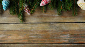 Green spruce branch and xmas decorations Stock Images
