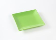 Green square plate Stock Photos