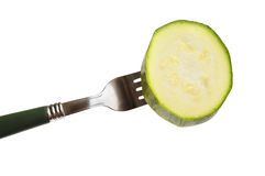 Green squash on a fork Stock Photo