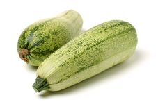 Green squash zucchini. Isolated on the white background stock images