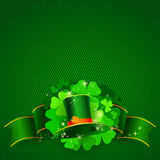 Green St. Patrick`s day background with hat and clover Stock Photo