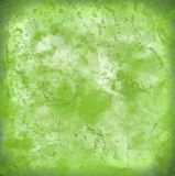 Splatter stained green worn texture old paper background no i. Green stains old splatter paper that has got worn look. Perfect for background royalty free stock image
